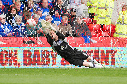 04.05.2013 Nottingham, England.  Leicester's Kasper Schmeichel makes a diving save during the Championship game between Nottingham Forest and Leicester City from the City Ground.