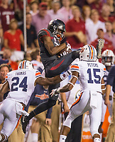 Hawgs Illustrated/BEN GOFF <br /> Jordan Jones, Arkansas wide receiver, catches a pass for 17 yards under defense from Daniel Thomas, Auburn strong safety, and Jordyn Peters, Auburn nickel back, in the first quarter Saturday, Oct. 21, 2017, at Reynolds Razorbacks Stadium in Fayetteville.