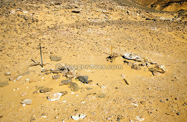Africa, Libya, Fezzan. Two graves in a valley of the Gebel Sherif mountains southwest of Kufra. During Second World War on January 31 1941 the Long Range Desert Group was attacked by the Italian Compagnie Sahariane. Libyen 1999/2000.<br /> <br />  --- No releases available. Automotive trademarks are the property of the trademark holder, authorization may be needed for some uses.<br /> <br />  --- INFO: The Long Range Desert Group (LRDG) was a reconnaissance and raiding unit of the British Army during the Second World War. Originally called the Long Range Patrol Unit (LRP), the unit was founded in Egypt in June 1940 by Major Ralph A. Bagnold. Bagnold was assisted by Captain Patrick Clayton and Captain William Shaw. At first the majority of the men were from New Zealand, but they were soon joined by Rhodesian and British volunteers, whereupon new sub-units were formed and the name was changed to the better-known Long Range Desert Group (LRDG).<br /> <br /> The LRDG vehicles were mainly two wheel drive, chosen because they were lighter and used less fuel than four wheel drive. They were stripped of all non-essentials, including doors, windscreens and roofs. They were fitted with a bigger radiator, a condenser system, built up leaf springs for the harsh terrain, wide, low pressure desert tyres, sand mats and channels etc. Wireless trucks had special compartments built into the bodywork to house wireless equipment. Initially the LRDG patrols were equipped with one CMP Ford 15 cwt F15 truck for the commander, while the rest of the patrol used up to 10 Chevrolet 30 cwt WB trucks.<br /> <br /> On 31 January 1941 'T' Patrol commanded by Captain Patrick Clayton was attacked by the Compagnia Autosahariana di Cufra, an Italian unit similar to the LRDG, in the Gebel Sherif valley south of Cufra, Libya. The LRDG had one man killed and three men captured, and three of the eleven trucks were destroyed during the battle. The Italians losses were five killed and three wounded, and on