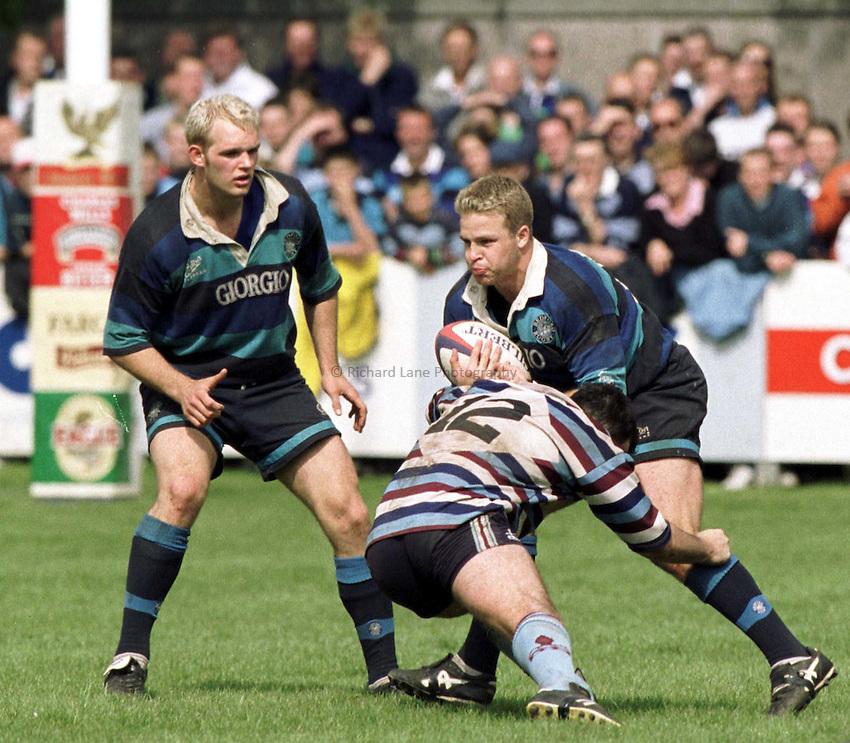Photo. Richard Lane.Bedford v Rotherham . 23/5/99. .Dan Harris breaks the tackle of Matt Walker as James Cockle waits for support.