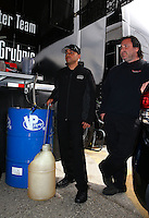 Mar 29, 2014; Las Vegas, NV, USA; NHRA top fuel driver J.R. Todd with crew members during qualifying for the Summitracing.com Nationals at The Strip at Las Vegas Motor Speedway. Mandatory Credit: Mark J. Rebilas-