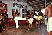 Alagoas State, Brazil. Young men practising capoeira with musician playing berimbau; Quilombo Curiau.