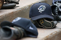 Charlotte Knights hats and gloves sit on the dugout steps at Durham Bulls Athletic Park in Durham, NC, Sunday, August 5, 2007.