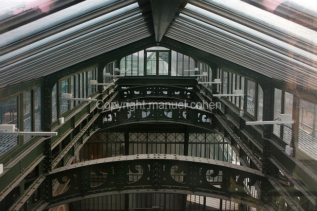 New Caledonia Glasshouse (formerly The Mexican Hothouse), 1830s, Charles Rohault de Fleury, Jardin des Plantes, Museum National d'Histoire Naturelle, Paris, France. Detail of the glass and metal roof structure seen in the morning light.
