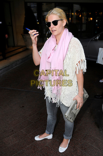 ELISHA CUTHBERT  .Spotted at a hotel in London, England..June 14th, 2011.*Exclusive All-Rounder*.full length jeans denim pink scarf white crochet poncho top sunglasses shades pumps shoes pen hand arm grey gray clutch bag.CAP/IA.©Ian Allis/Capital Pictures.