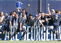 Steve Neumann #18 with Seth C'deBaca #4 and Joey Dillon #2 of Georgetown University after he scored during an NCAA match against Michigan State at North Kehoe Field, Georgetown University on September 5 2010 in Washington D.C. Georgetown won 4-0.
