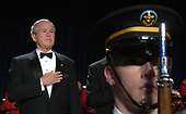 Washington, D.C. - April 29, 2006 -- United States President  George W. Bush stands at attention as the Star Spangled Banner is played before the White House Correspondents' Association Dinner in Washington on April 29, 2006.   <br /> Credit: Roger L. Wollenberg - Pool via CNP