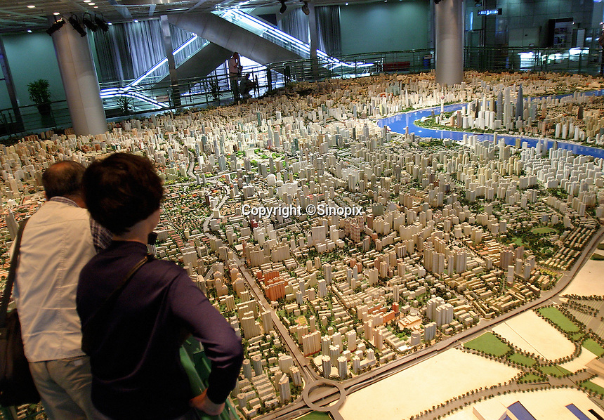 Visitors look at a model map of what municipal planners hope Shanghai will eventually look like at the Shanghai City Planning Museum in Shanghai, China. Already a city of 20 million residents, Shanghai is well on its way of becoming one of the major metropolis of the world..