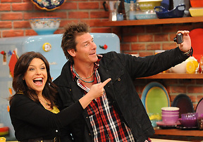 Rachael Ray talks with Ty Pennington during the production of The Rachael Ray Show in New York on Tuesday, December 1, 2009..Photo: David M. Russell/The Rachael Ray Show