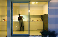 The kitchen opens on to the inner courtyard through large sliding patio doors