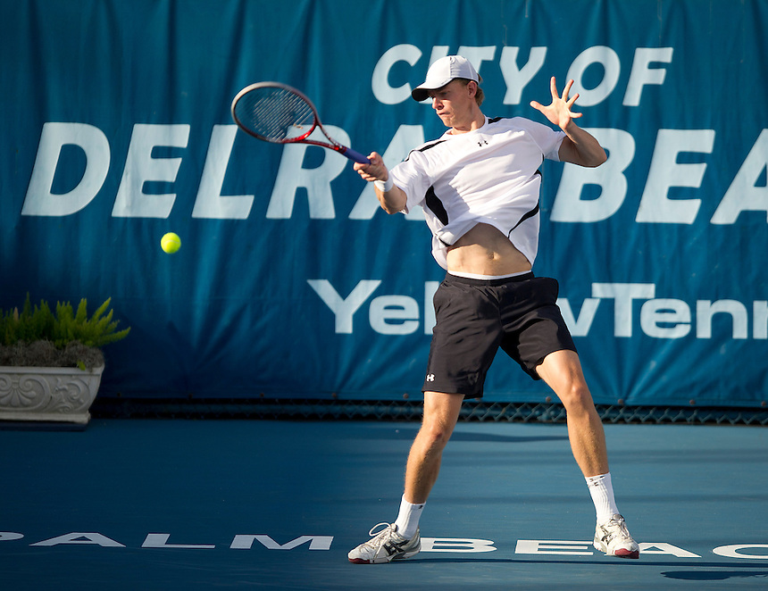 Kevin Anderson (RSA) in action during his victory over Marinko Matosevic (AUS)  in their Final match today - Kevin Anderson (RSA) def Marinko Matosevic (AUS) 7-5 7-6(4)..ATP 250 Tennis - 2012 Delray Beach International Tennis Championships - Day 7 - Sunday 04 March 2012 - Delray Beach Stadium & Tennis Center - Delray Beach - Florida - USA..