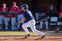 Ryan Hill (16) of the Shippensburg Raiders follows through on his swing against the Belmont Abbey Crusaders at Abbey Yard on February 8, 2015 in Belmont, North Carolina.  The Raiders defeated the Crusaders 14-0.  (Brian Westerholt/Four Seam Images)