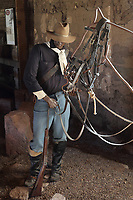 Cavalryman, in the Enlisted Men's Barracks, at Fort Davis National Historic Site, a US army fort established 1854, in a canyon in the Davis Mountains in West Texas, USA. The cavalry, first called the Mounted Dragoons, were used infrequently until the mid-1800s when the frontier had pushed westward into the Great Plains, when the nomadic culture of the Indians and the vastness of the West made the cavalry necessary. The fort was built to protect emigrants, mail coaches, and freight wagons on the trails through the State from Comanche and Apache Indians. After the Civil War, several African-American regiments were stationed here. By the 1880s, the fort consisted of one 100 buildings, housing over 400 soldiers. It was abandoned in 1891, but many buildings have been restored and the compound now operates as a historical site and museum. Picture by Manuel Cohen