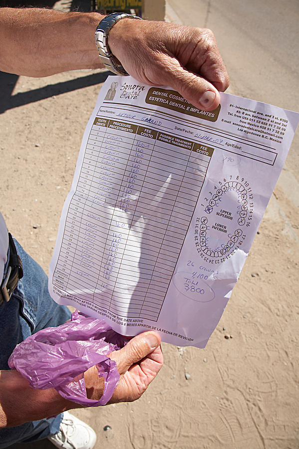 Man holding a estimate for dental work in Los Algodones, B.C, Mexico.