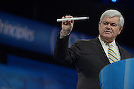March 14, 2013  (National Harbor, Maryland)  Former Speaker of the House Newt Gingrich holds a prop as he addresses the 2013 Conservative Political Action Conference (CPAC) in National Harbor, MD.  (Photo by Don Baxter/Media Images International)