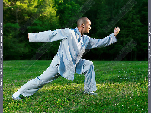 Shaolin monk practicing internal Kung Fu in the nature