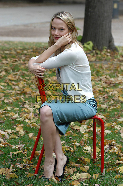 "MILO ADDICA.James Marsh's film ""The King"" photocall held at Casa Del cinema, Rome..21st November 2005.Ref:Luca Cavallari.half length blue dress silk satin white cardigan seated sat on red chair leaning face cheak on hand.www.capitalpictures.com.sales@capitalpictures.com.© Capital Pictures."