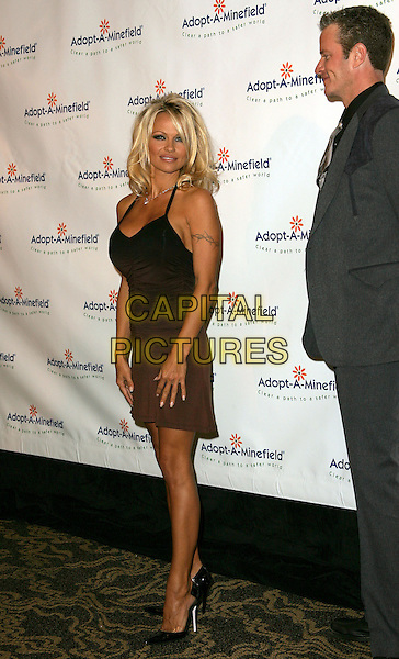 PAMELA ANDERSON & VP of Peta, DAN MATHEWS -MATTHEWS.The 4th Annual Benefit Gala for Adopt-A-Minefield held at The Century Plaza Hotel in Century City, California.October 15th, 2004.full length, brown, black dress, tattoo.www.capitalpictures.com.sales@capitalpictures.com.©Debbie Van Story/Capital Pictures