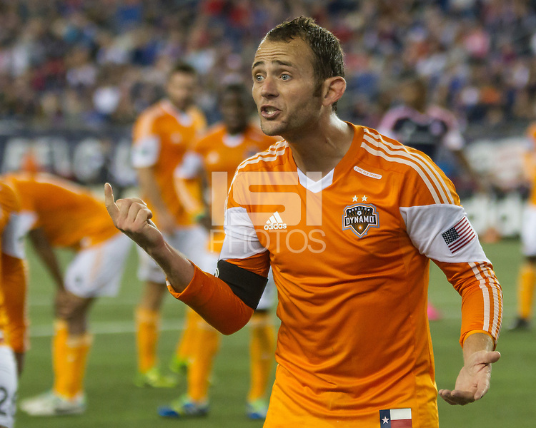 Houston Dynamo forward Brad Davis (11) appeals against a free kick.   The New England Revolution played to a 1-1 draw against the Houston Dynamo during a Major League Soccer (MLS) match at Gillette Stadium in Foxborough, MA on September 28, 2013.