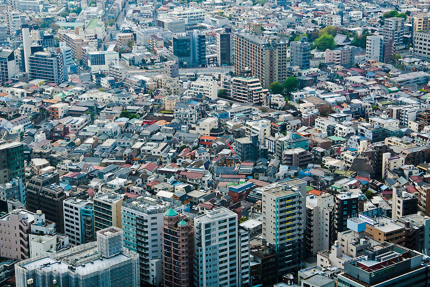 Tokyo`s cramped & varied housing seen from an aerial view point. Old housing and newer high rises.
