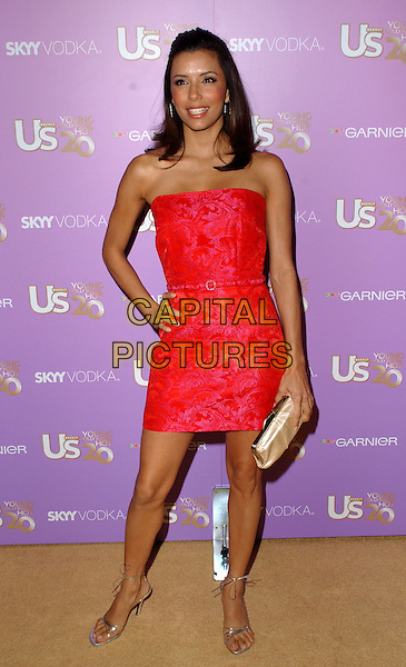 EVA LONGORIA.Attends The US Weekly Young Hollywood Hot 20 Party held at LAX in Hollywood,.Los Angeles, 16th September 2005.full length red fitted dress hand hip clutch bag.Ref: DVS.www.capitalpictures.com.sales@capitalpictures.com.Supplied By Capital PIctures