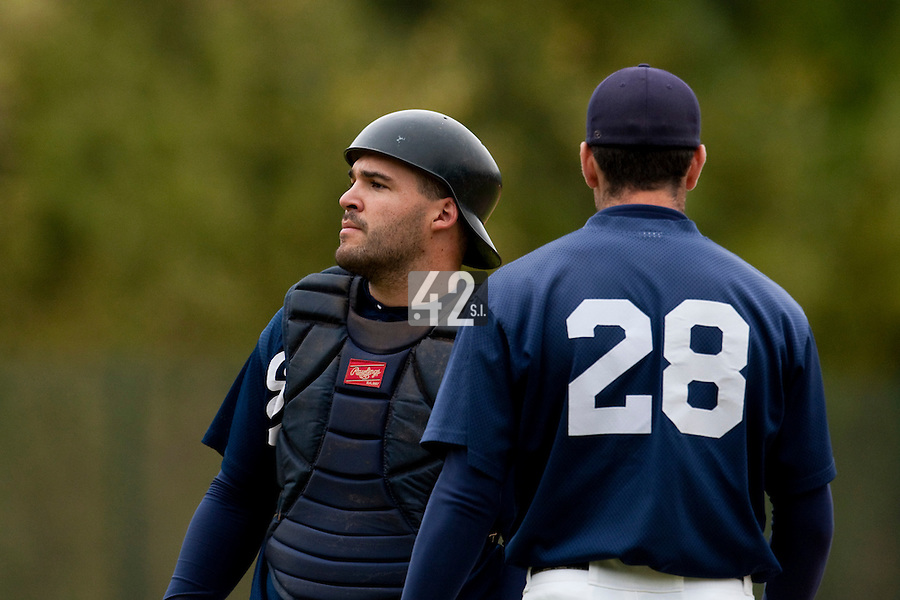 03 october 2009: Vincent Ferreira of Savigny talks to Pierrick Le Mestre during game 1 of the 2009 French Elite Finals won 6-5 by Rouen over Savigny in the 11th inning, at Stade Pierre Rolland stadium in Rouen, France.
