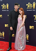 Madelaine Petsch &amp; Travis Mills at the 2018 MTV Movie &amp; TV Awards at the Barker Hanger, Santa Monica, USA 16 June 2018<br /> Picture: Paul Smith/Featureflash/SilverHub 0208 004 5359 sales@silverhubmedia.com