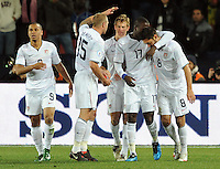Clint Dempsey (8) of USA is congratulated by his team-mates after scoring the opening goal. USA leads Brazil 2-0 after the first half during the FIFA Confederations Cup Final at Ellis Park Stadium in Johannesburg, South Africa on June 28, 2009..