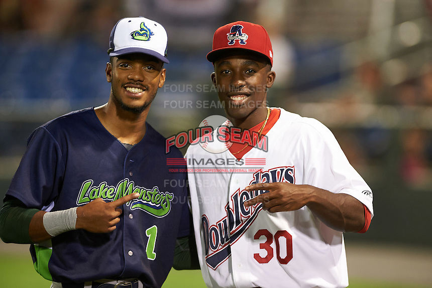 Vermont Lake Monsters James Terrell (1) and Auburn Doubledays Daniel Johnson (30) after a game on July 12, 2016 at Falcon Park in Auburn, New York.  Auburn defeated Vermont 3-1.  (Mike Janes/Four Seam Images)