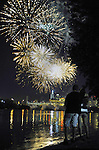 Braho Hodzic and his girl friend Katy Anderson, both from Vernon, watch the fireworks over the Hartford skyline from the banks of the Connecticut River in East Hartford, the Riverfest fireworks were originally scheduled for July 6 but postponed due to flooding on the Connecticut River from heavy rains in June and early July.  (Jim Michaud / Journal Inquirer)