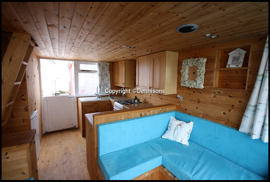 BNPS.co.uk (01202 558833)<br /> Pic: Dennisons/BNPS<br /> <br /> A beach hut that has no running water, mains electricity or toilet has gone on the market for the 'sensible price' of £275,000.<br /> <br /> That is because the timber cabin is on a famous sandy peninsula that is home to Britain's most expensive beach huts.<br /> <br /> Hut 325 is located in the middle of the Mudeford Sandbank in Christchurch, Dorset. It sleeps up to six people and has stunning sea views looking out to the Isle of Wight.
