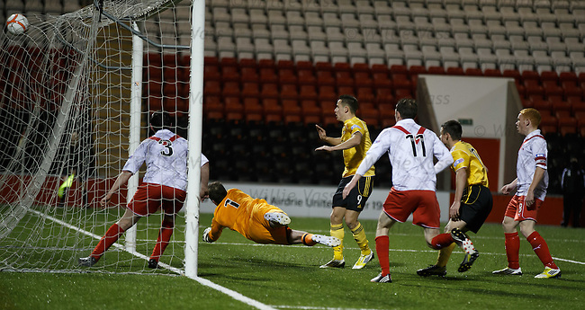 Marc McNulty swivels and scores for Livi