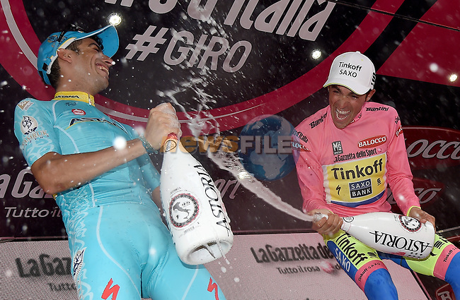 Alberto Contador (ESP) Tinkoff-Saxo celebrates on the podium with Fabio Aru (ITA) Astana after winning the 98th Giro d'Italia 2015 at the end of the final Stage 21, running 178km from Turin to Milan. 31st May 2015. <br /> Photo: ANSA/Daniel Dal Zennaro/www.newsfile.ie