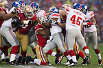 San Francisco 49ers defense gang tackles New York Giants running back Ahmad Bradshaw (44) during an NFC Championship NFL football game on January 22, 2012 in San Francisco, California. The Giants won 20-17 in overtime. (AP Photo/David Stluka)