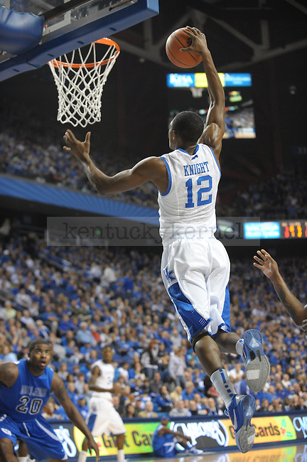Freshman Brandon Knight goes up for a dunk during the UK mens basketball Dillard exhibition game. Photo by Mike Weaver | Staff