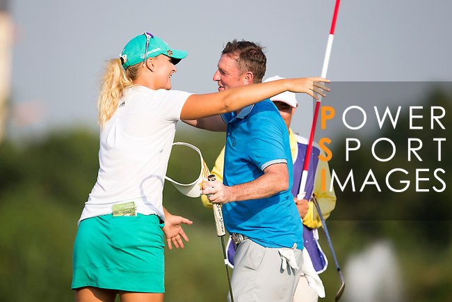 Anna Nordqvist (left) bumps fists and hugs Lee Sharpe at the end of their game during the World Celebrity Pro-Am 2016 Mission Hills China Golf Tournament on 23 October 2016, in Haikou, Hainan province, China. Photo by Victor Fraile / Power Sport Images
