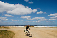 "A Cuban man rides a bicycle on the dusty road along the sea, carrying vegetables from his garden to his home in Alamar, a huge public housing complex in the Eastern Havana, Cuba, 5 February 2009. The Cuban economic transformation (after the revolution in 1959) has changed the housing status in Cuba from a consumer commodity into a social right. In 1970s, to overcome the serious housing shortage, the Cuban state took over the Soviet Union concept of social housing. Using prefabricated panel factories, donated to Cuba by Soviets, huge public housing complexes have risen in the outskirts of Cuban towns. Although these mass housing settlements provided habitation to many families, they often lack infrastructure, culture, shops, services and well-maintained public spaces. Many local residents have no feeling of belonging and inspite of living on a tropical island, they claim to be ""living in Siberia""."