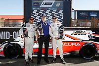 #6 Acura Team Penske Acura DPi, DPi: Juan Pablo Montoya, Dane Cameron, podium, with Ted Klaus, HPD President