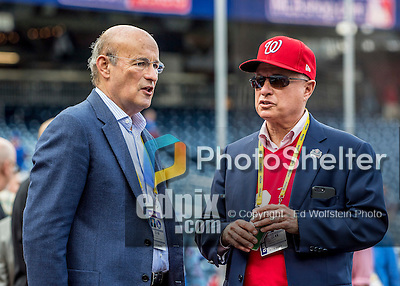 7 October 2016: Los Angeles Dodgers President and CEO Stan Kasten chats with Washington Nationals Owner Mark Lerner during batting practice, prior to the first game of the NLDS at Nationals Park in Washington, DC. The Dodgers edged out the Nationals 4-3 to take the opening game of their best-of-five series. Kasten was the former President of the Nationals from 2006 to 2010, the Atlanta Braves from 1986 to 2003, and now has a part ownership of the Los Angeles Dodgers. Mandatory Credit: Ed Wolfstein Photo *** RAW (NEF) Image File Available ***