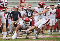 Hawgs Illustrated/BEN GOFF <br /> Matthew Phillips kicks an extra point with Reid Bauer holding in the fourth quarter Saturday, April 6, 2019, during the Arkansas Red-White game at Reynolds Razorback Stadium.