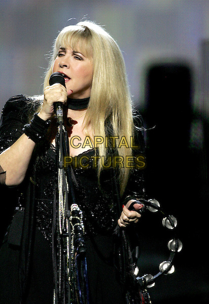 "STEVIE NICKS.Performs live for a four night production called ""Dreams"" exclusively at The Colosseum in Caesars Palace in Las Vegas, Nevada .May 11th, 2005.half length stage concert live gig performance singing tambourine.www.capitalpictures.com.sales@capitalpictures.com.Supplied By Capital PIctures"