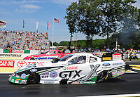 Jun. 3, 2012; Englishtown, NJ, USA: NHRA funny car driver Mike Neff (near lane) races alongside Bob Tasca III during the Supernationals at Raceway Park. Mandatory Credit: Mark J. Rebilas-