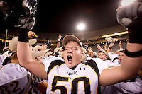 1129101140jlw  4A1foot1205  Saguaro's  Devon Clark (CQ) celebrates after winning the 4AI State Championship against Canyon del Oro Saturday at Sun Devil Stadium. (Pat Shannahan/ The Arizona Republic)