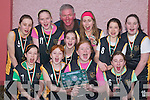 CELEBRATING: The Currow Under 12 Ladies Basketball Team who won the County.League, celebrate after receiving their medals in Currow Community Centre on Saturday..Front row l-r: Pataire Fleming, Erin OConnor, Sorcha Fleming and Orla Brosnan. Back.row l-r: Marie Brosnan, Colleen Breen, Ashling OSullivan, Bertie Griffin (Coach), Niamh.Sheehy, Shauna Fleming and Lorna OShea.
