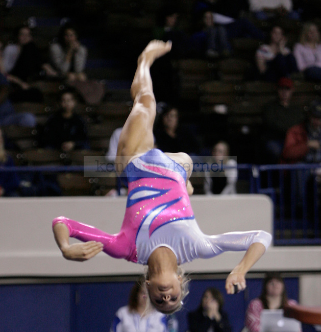 UK sophomore Holly Cunningham performs her beam routine during the gymnastics meet between Kentucky, Auburn, and Pittsburgh on 2/24/12 at Memorial Coliseum in Lexington, Ky. Photo by Quianna Lige | Staff