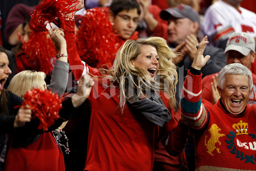 Ohio State fans Taylor Knight of Cleveland and Richard Stuck of Pittsburg celebrate an Ohio State touchdown by Ohio State Buckeyes wide receiver Philly Brown (10) during the second quarter of the Big Ten championship football game at Lucas Oil Stadium in Indianapolis on Dec. 7, 2013. (Adam Cairns / The Columbus Dispatch)