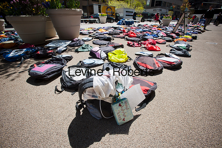 """Hundreds of backpacks are displayed in Madison Square in New York on Thursday, April 5, 2012 as part of the """"Send Silence Packing"""" initiative of Active Minds Inc., a group that works toward suicide prevention among college students. The backpacks, part of 1100 on tour, represent the 1100 college students who die via suicide each year. Suicide is the second largest cause of death among college students. (© Richard B. Levine)"""