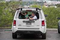 NWA Democrat-Gazette/J.T. WAMPLER Ben Sexton of Fayetteville and his son Jude, 2, watch services from the back of their car Sunday April 16, 2017 at the 94th Annual Easter Sunrise Service at Mount Sequoyah in Fayetteville. Several hundred people attended the annual service at the Mount Sequoyah Retreat and Conference Center. Sexton and his wife Jessica thought their children including five month-old Lincoln (neither pictured) would be too disruptive so they watched the Easter service from a nearby parking space.