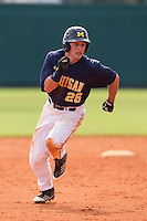 Michigan Wolverines outfielder Patrick Biondi #26 running the bases during a game against the Seton Hall Pirates at the Big Ten/Big East Challenge at Al Lang Stadium on February 18, 2012 in St. Petersburg, Florida.  (Mike Janes/Four Seam Images)