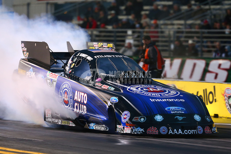 Feb 7, 2014; Pomona, CA, USA; NHRA funny car driver Robert Hight during qualifying for the Winternationals at Auto Club Raceway at Pomona. Mandatory Credit: Mark J. Rebilas-